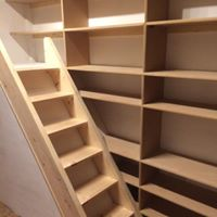 Bespoke floor to ceiling shelving to clients specification